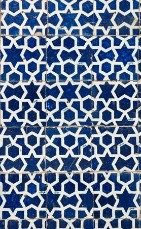 islamic art: tiled background, oriental ornaments from Isfahan Mosque, Iran Stock Photo