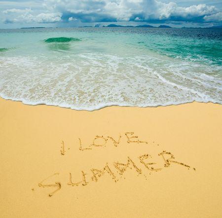 I  summer written in a sandy tropical beach photo