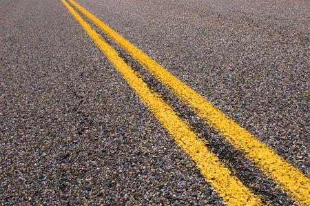 yellow dividing lines on the highway  photo