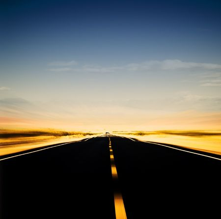 vibrant image of highway and blue sky in motion blur Stock Photo - 3296616