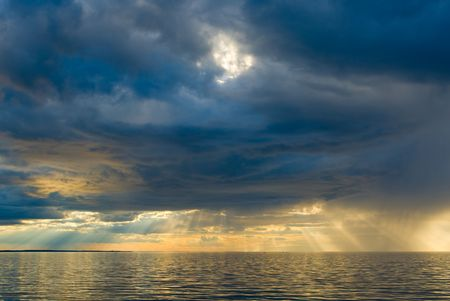 aura sun: Stormy sunset over the sea Stock Photo