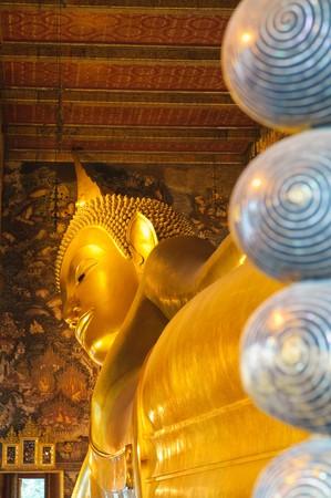 reclining buddha, wat pho, bangkok, thailand photo