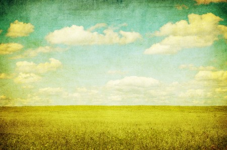 Image of sky: grunge image of green field and blue sky