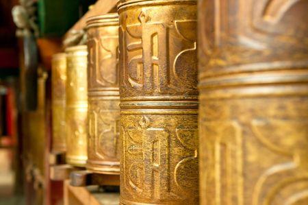 lamaism: tibetan prayer wheels in songzanlin tibetan monastery, shangri-la, china
