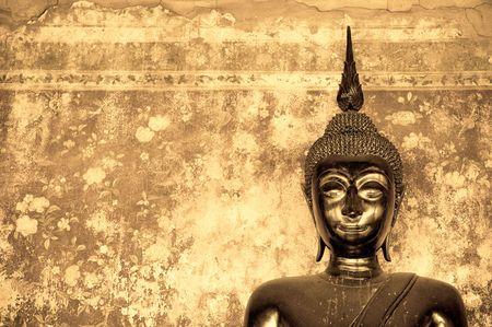 buddha over grunge wall photo