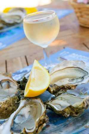 oyster: fresh oysters and a glass of wine Stock Photo