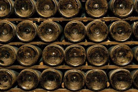 dark cave: bottles in wine cellar