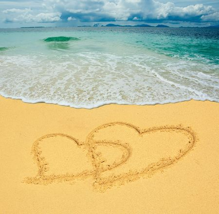 two hearts drawn in a sandy tropical beach photo