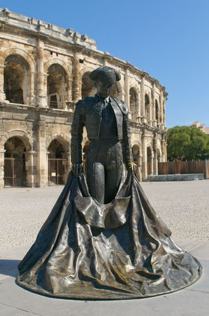 Monumetnt of matador in front of Arenas of Nimes photo