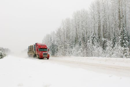 red truck on winter road photo
