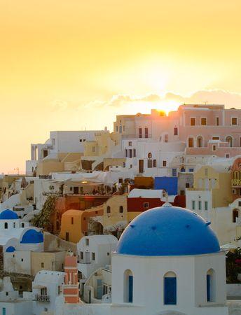Oia village at sunset, Santorini island, Greece photo