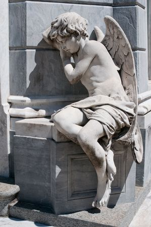 headstone: Angel statue at Recoleta cemetery, Buenos Aires Stock Photo