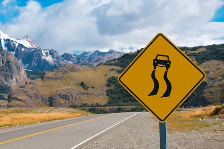 slippery when wet warning road sign Stock Photo - 6910696