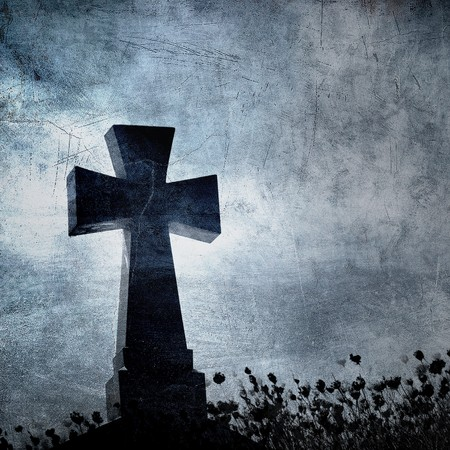 Grunge image of a cross in the cemetery, perfect halloween background photo