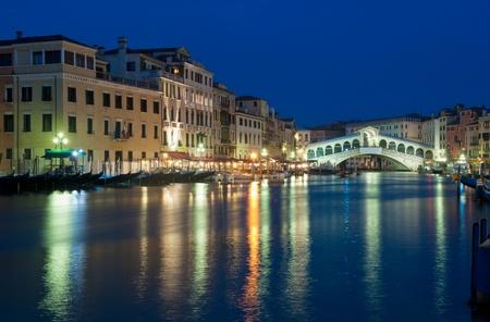 Rialto bridge at night, Venice, Italy photo