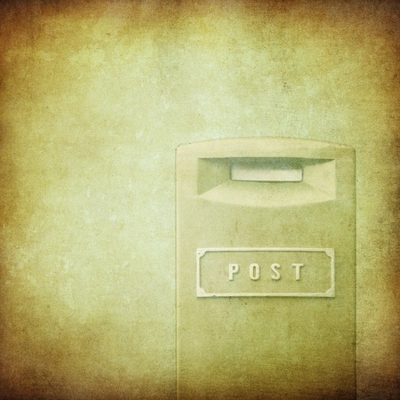 yellow mail-box over grunge background photo