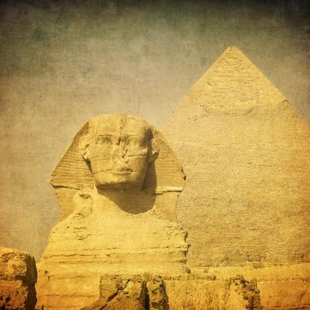 giza: grunge image of sphynx and pyramid Stock Photo