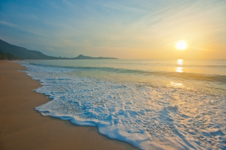 Tropical beach at sunrise photo