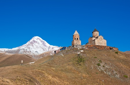 Mount Kazbek and Trinity Monastery, Georgia Stock Photo - 12360891