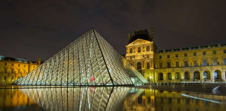 pyramid shape: Louvre museum at night, Paris, France