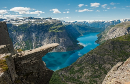 Trolltunga, Trolls tongue rock above lake Ringedalsvatnet, Norway photo
