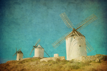 don quixote: Vintage image of windmills in Consuegra, Spain