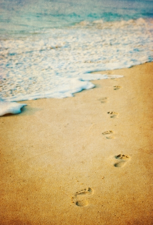 footprints sand: grunge image of footprints in a tropical beach Stock Photo