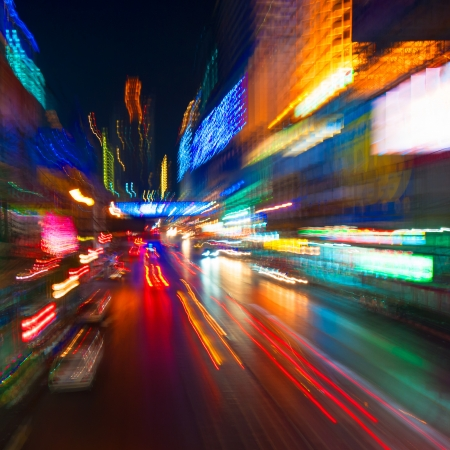 city by night: traffic lights in motion blur