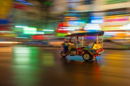 bangkok landmark: Tuk-tuk in motion blur, Bangkok, Thailand Stock Photo