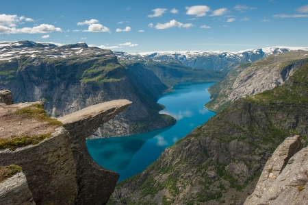 hardanger: Trolltunga, Trolls tongue rock above lake Ringedalsvatnet, Norway Stock Photo