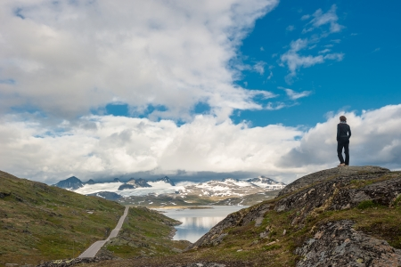 lonely road: Silhouette of traveler at Scenic 55 road, Norway Stock Photo
