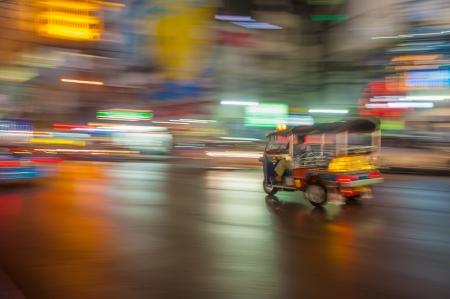 Tuk-tuk in motion blur, Bangkok, Thailand Stock Photo