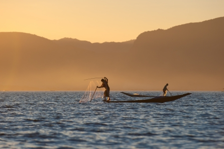 Fishermen at Inle lake, Myanmar photo