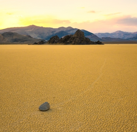 dry stone: Sailing stones in the Racetrack Playa, Death Valley, California Stock Photo