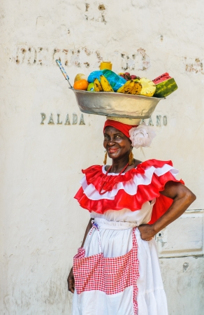 CARTAGENA, COLOMBIA - December, 02: Palenquera woman sells fruits at Plaza Santo Domingo on December, 02, 2009 in Cartagena, Colombia
