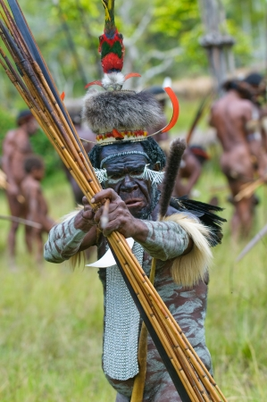 papua: WAMENA, PAPUA, INDONESIA - November, 14: Yali Mabel, the chief of Dani tribe performing traditional fighting dance on November, 14, 2008 near Wamena, Papua, Indonesia. Editorial
