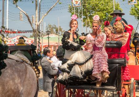 courteous: SEVILLE, SPAIN - April, 25: Parade of carriages at the Sevilles April Fair  on April, 25, 2012 in Seville, Spain Editorial