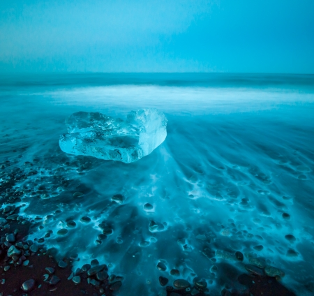 Floating icebergs in Jokulsarlon Glacier Lagoon, Iceland photo