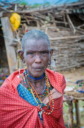 MASAI MARA, KENYA - September, 23: Old Masai woman on September, 23, 2008 in Masai Mara National Park, Kenya