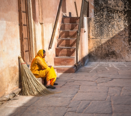 JAIPUR, RAJASTAN, INDIA - January, 27: Cleaning woman in Amber Fort on December, 02, 2009 in Jaipur, Rajasthan, India.