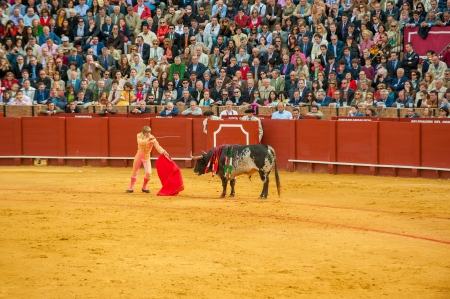 capote: SEVILLE, SPAIN - April, 28: Matador Manuel Diaz el Cordobes at Maestranza bullring on April, 28, 2012 in Seville, Spain