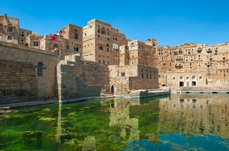 mud house: Water cistern at Hababah traditional village, Yemen