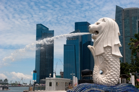SINGAPORE - August, 22, 2010:  Merlion statue, landmark of Singapore. It's a mythical creature with the head of a lion and the body of a fish.