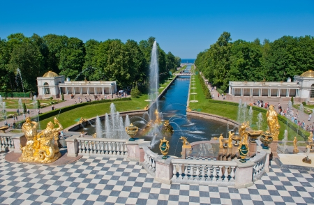 "SAINT PETERSBURG, RUSSIA - July, 05, 2010: Fountains of Petergof. Petergof Palace is a series of palaces and gardens sometimes referred as the ""Russian Versailles"". It's recognized as a UNESCO World Heritage Site."