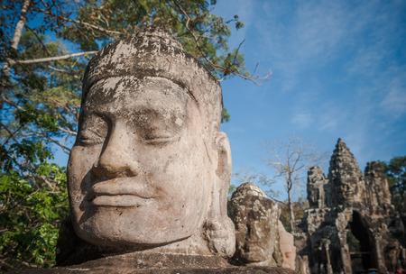 Head of gate guardian, Angkor, Cambodia photo