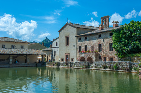 thermal spring: Ancient swimming pool with thermal water in Bagno Vignoni, Tuscany  Stock Photo