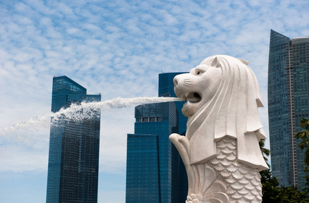 merlion: SINGAPORE - August, 22, 2010:  Merlion statue, landmark of Singapore. It's a mythical creature with the head of a lion and the body of a fish.