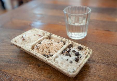 Shot of mezcal and sal de gusano, Traditional mexican drink, Oaxaca, Mexico photo