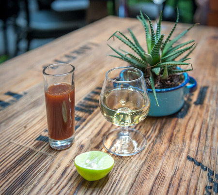 Shot of tequila, sangrita and lime - drink mexican style