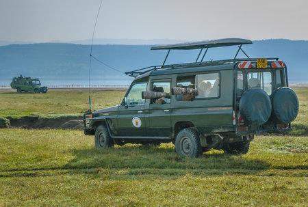 birdwatcher: AMBOSELI, KENYA - September, 21, 2008: Birdwatching photography safari in Lake Nakuru National Park, Kenya Editorial